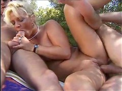 Slut does a double penetration in the outdoors