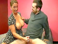 Doll with big tits is doing handjob