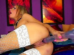 Hot blooded babe Leyla Black sticks a massive dildo