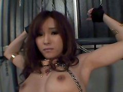 Chained oriental girl MEI HARUKA gets her pussy fingerfucked