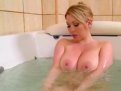 Nude blonde is washing her boobs