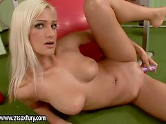 Arousing naive looking blonde teen with stunning natural hooters and