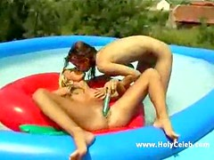 Girls in the pool using toy in pussy