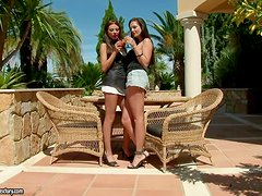 Two stunning brunettes lick each others pussies outside the house
