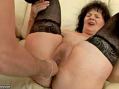 Nasty granny Helena May in black stockings gets her pussy
