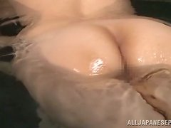 Asian chick plays with her tits and vag in the presence of two men