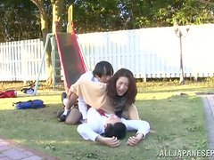 Japanese chick in stockings gets threesomed in a park