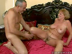 Horny and busty mature granny with a pretty hairy pussy