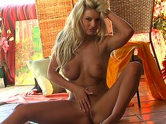 Tanned blonde Tommie Jo takes off her lingerie