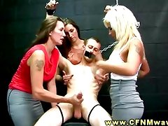 CFNM foursome dungeon as stud is tied up