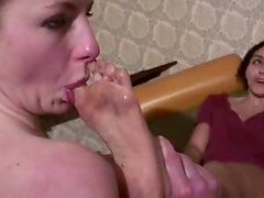 Blonde girl licks the dirty feet of her mistress