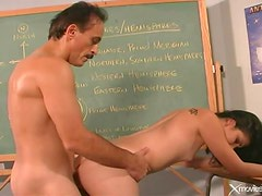 Her mature teacher stuffs his dick in her pussy