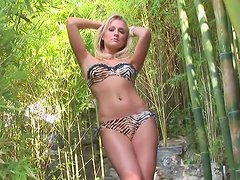 Cute blonde Traci Denee poses in the green forest