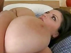 Thick and juicy Arianna Sinn grabs her huge juggs as cock slams her moist twat