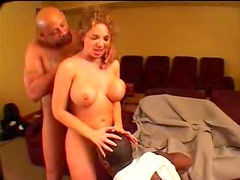 Black guys eat her cunt and play with her tits
