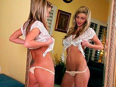 Divine blondie Staci Silverstone masturbates in front of the mirror