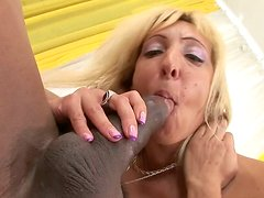 Ugly blond bitch goes wild riding a strong long and hot black cock