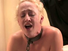 Dylan moans in pleasure while getting her cunt fingered in BDSM scene