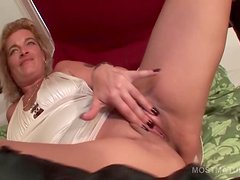 Blonde mature lady masturbating sweet pussy in bed