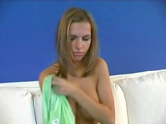 Goatish blonde exposes vulva