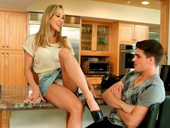 Lustful Brandi Love is getting her tasty cooch polished on a kitchen counter