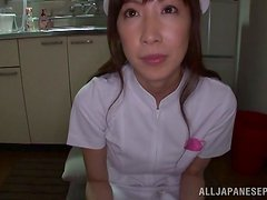 Japanese nurse toys her pussy with a vibrator in a hospital