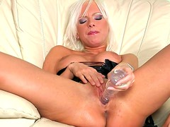 Pretty blonde Alexis takes off her black lingerie