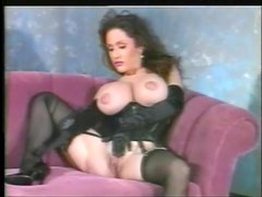 Black lingerie and satin gloves on this busty solo girl
