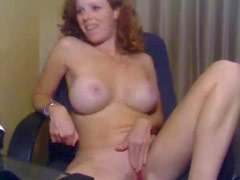 Girl with curly red hair masturbating