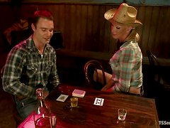 Hot blonde tranny in cowboy hat fucks a guy in a bar