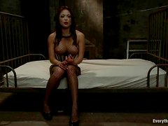 Two hot babes in fishnets have great anal sex in a dungeon