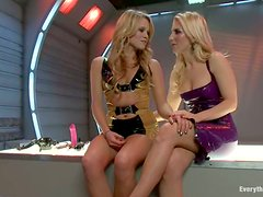 Two amazingly hot chicks in latex get their asses drilled
