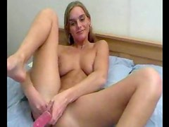 She does a dildo DP and she cums