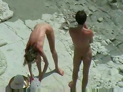 Babe bends over to take cock at beach