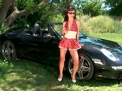 Asian in satin outfit teases body on her car