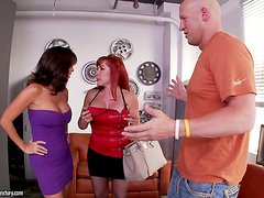 Tara Holiday and Vanessa Videl suck a big cock and ride it by turns