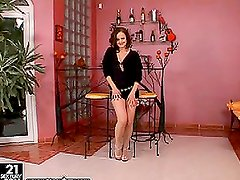Elegant girl in black toys her hot pussy lying on a chair
