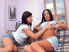 Leah and Luna lick each other's bodies and play with dildos