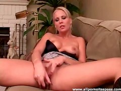 Perky titted blonde hottie using a silver dildo