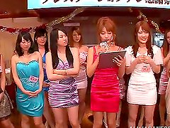 A few Japanese girls share two guys' dicks indoors