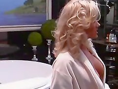 Gorgeous blond Amy McCarthy enjoys her tits in the mirror