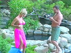 Lita the busty blonde rides her photographer's cock outdoors