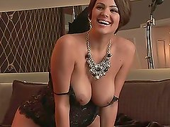 Sara Stokes the busty brunette shows her tits close ups