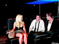 Busty blond babe gets a double penetration in the club