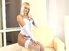 Blonde chick in lingerie and fishnets plays with her pussy
