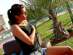 Hot brunette babe masturbating outdoors with a golden dildo