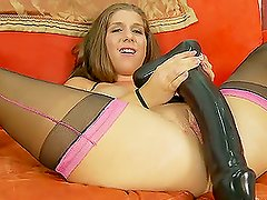 Slut Inserts Huge Cock-Shaped Dildos In Her Cunt.