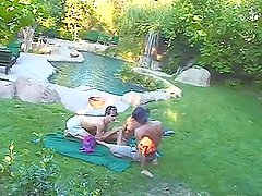 Two guys catch a sexy babe, fuck her and cover her nice tits with sperm