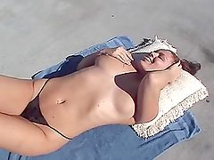 Claire Bandit gives a blowjob after sunbathing