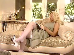 Adorable blonde babe getting fuked doggystyle on a sofa